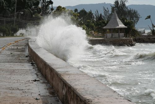 A seawall lets only some waves beyond